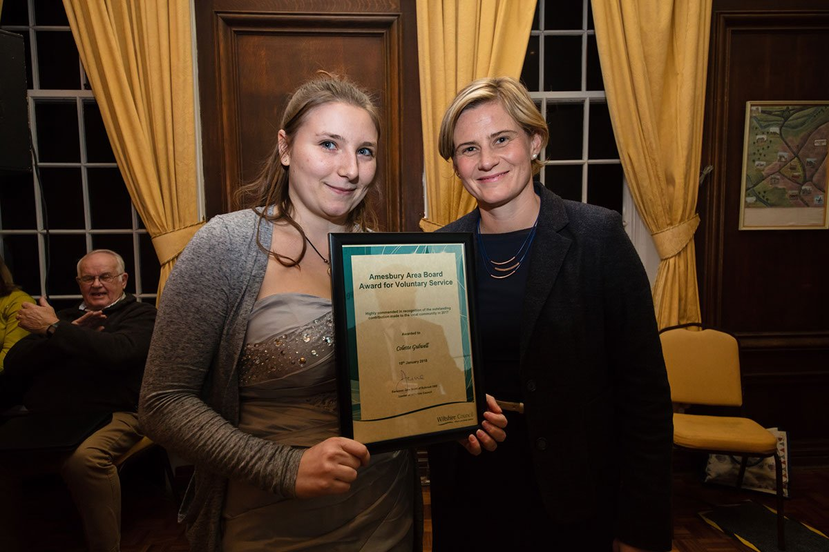 Collette receives her 'Highly Commended' certificate from Cornelia Oosthuizen